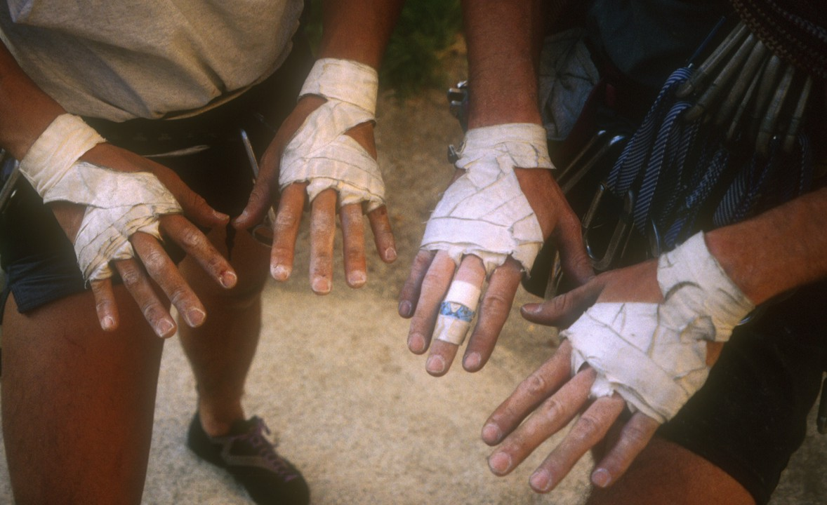 Taped up hands after a day of climbing in the Bighorn Mating Grotto; notice the Disney band-aid on the middle finger