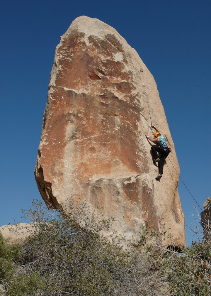 Making the crux moves on Boogers; the high bolt protects this section