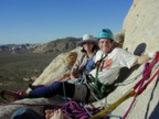 Eric and Lucie lounging at the belay at sunset