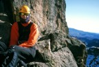 Sitting at a belay high on the route
