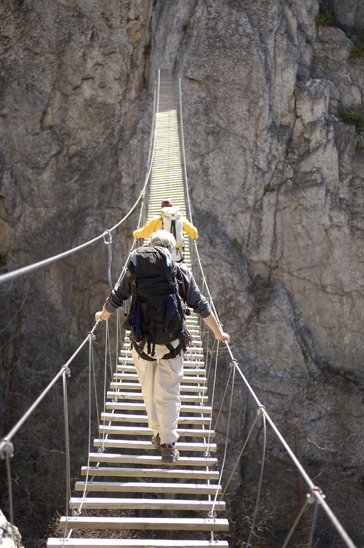 Crossing the bridge on the via ferrata