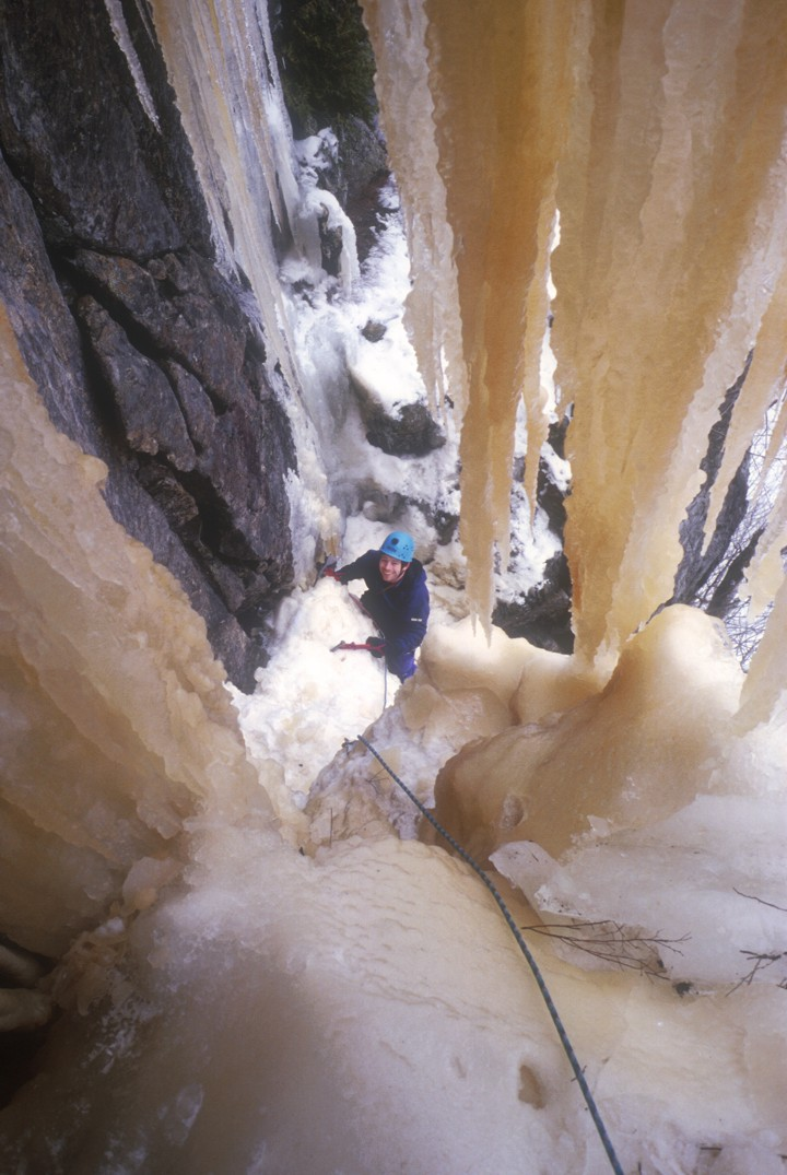 Eric seconding on the first ascent of Men With Guns