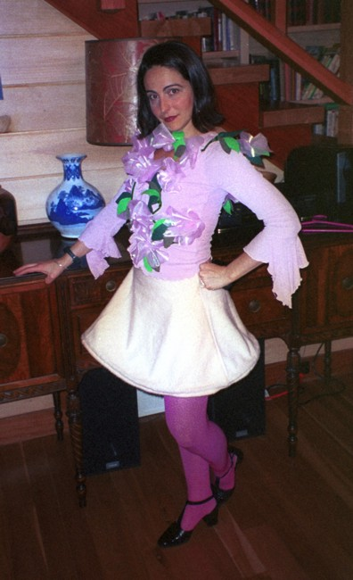 Lucie in her Halloween costume, dressed as a flower girl