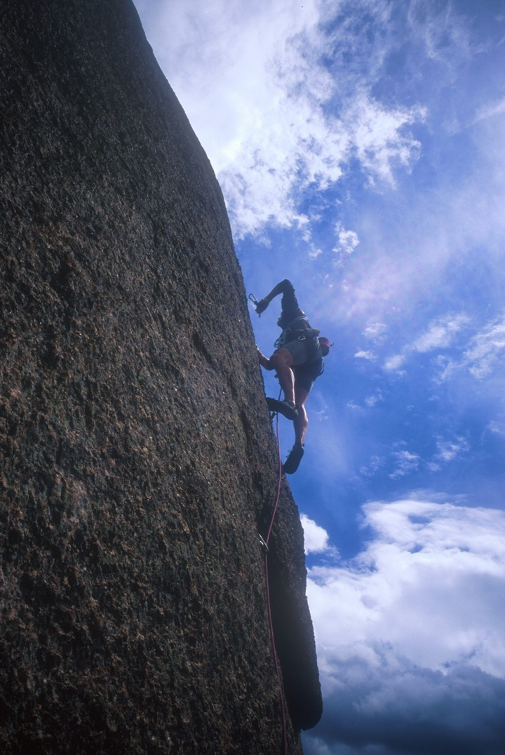 Climbing the thin face on the third pitch