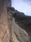 Tommy leads the first pitch (5.8) of Center Route; the second pitch ends below the large triangular roof above