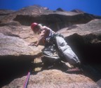 After making the crux moves, Tommy looks down for the camera
