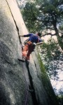Climbing a great layback flake in the Valley